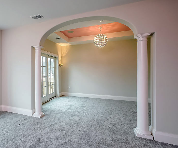 Elliptical arch with columns on the side for a Federal-style home interior
