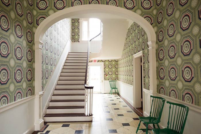 Patterned green wallpaper in a Federal-style landmark at the Dumbarton House in Washington DC