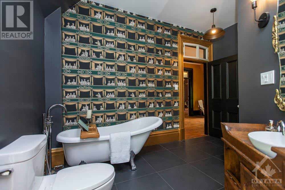 Gothic Victorian Home with bathroom patterned wallpaper