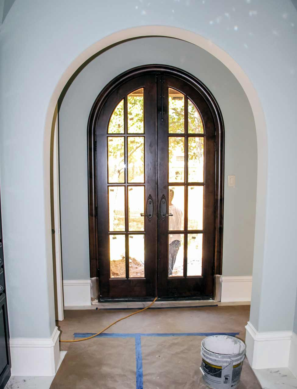 Half circle arch entry with arched wooden door