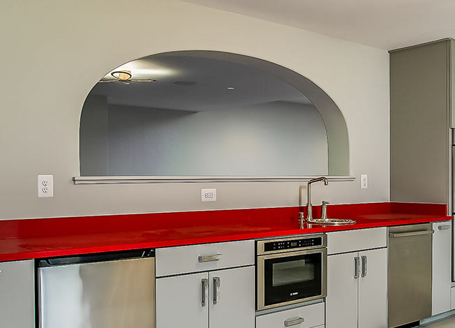 elliptical arch over kitchen passthrough in man cave