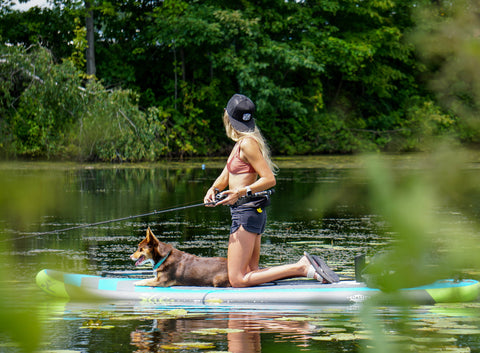 kayla jocumsen and her dog roo on a sup