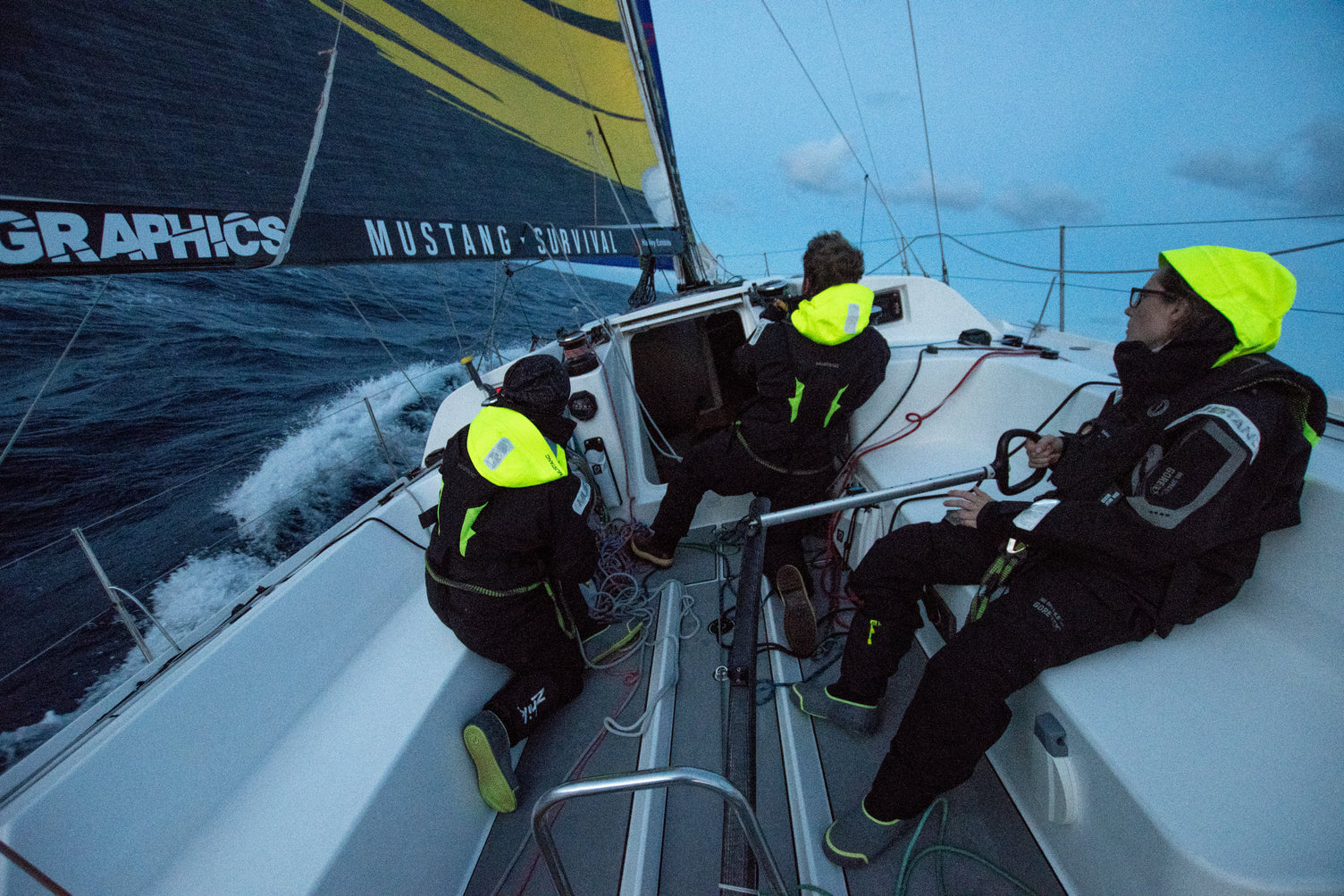 mustang survival sailing team bracing the conditions