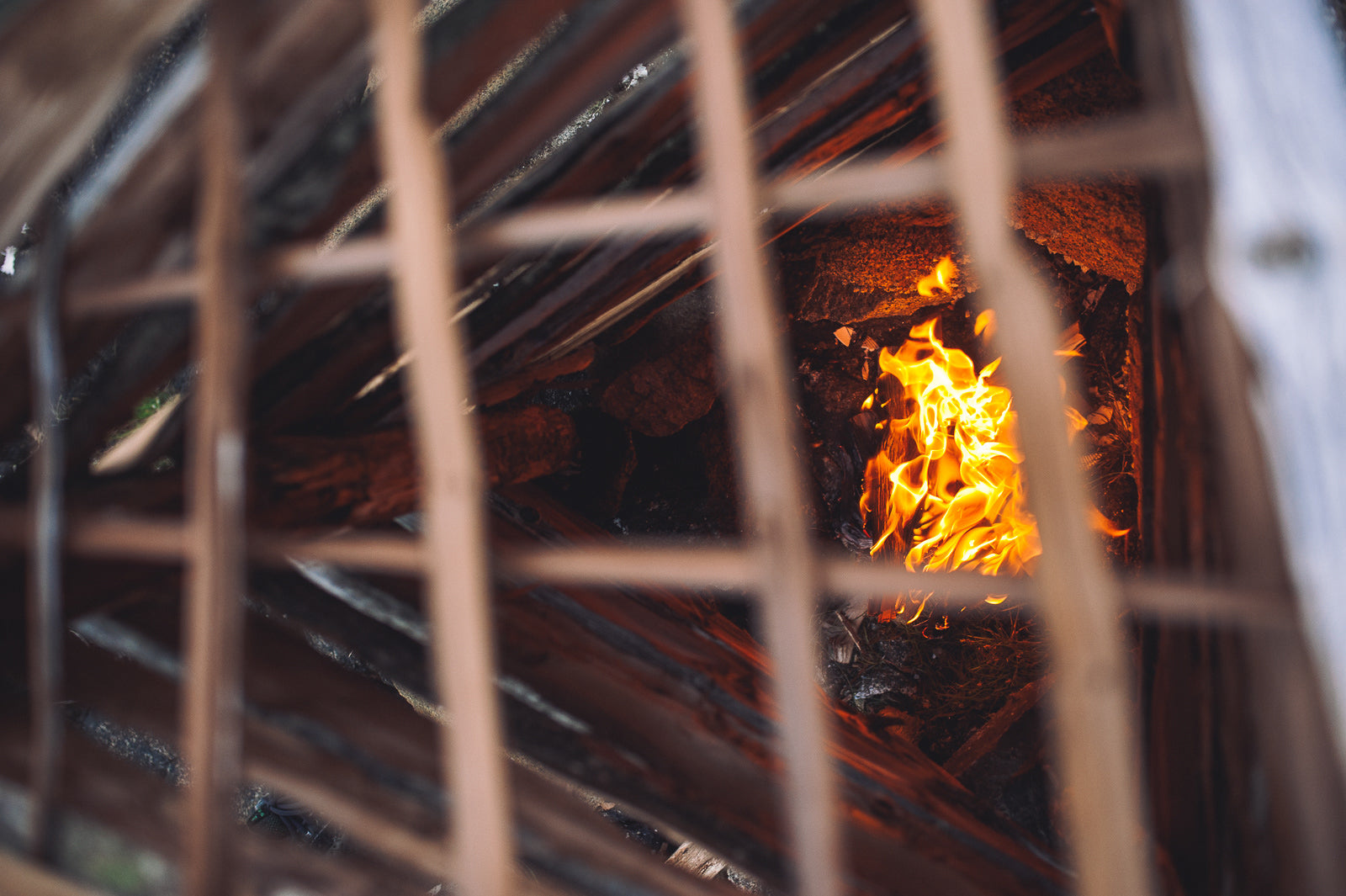 top view of fire in a home made wooden fish smoker