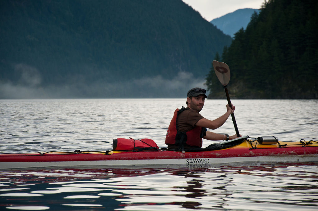 kayaker paddling off the west coast of Canada