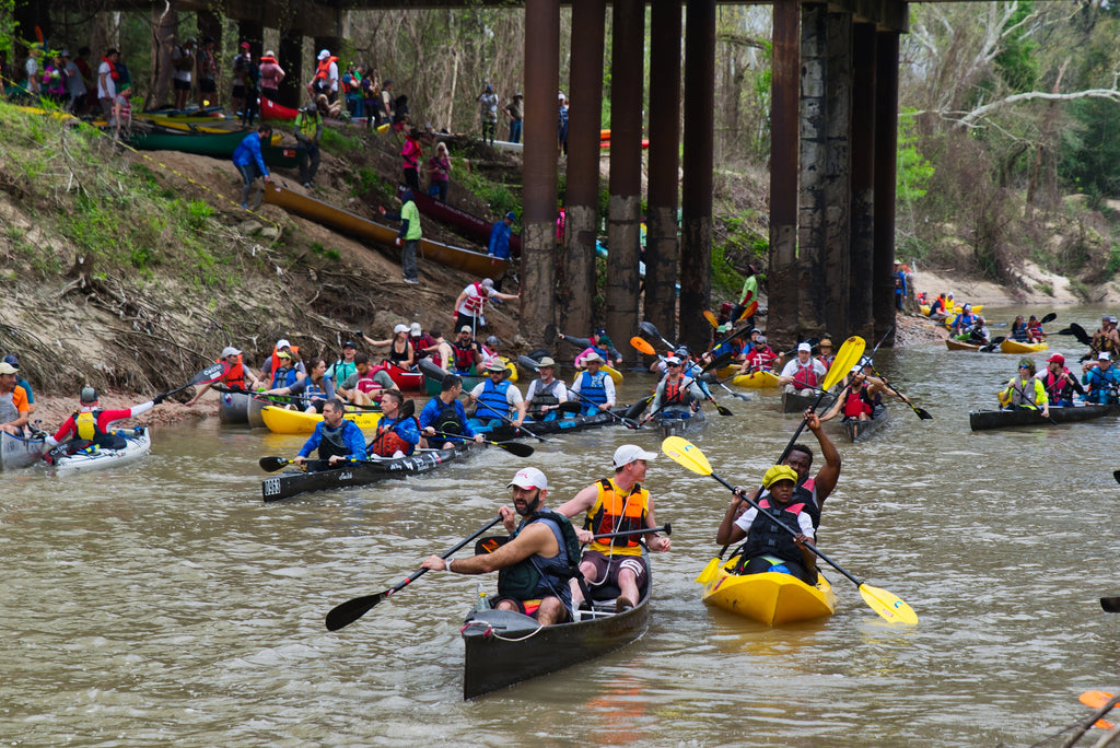 hundred of canoes and kayaks putting in the river for racing