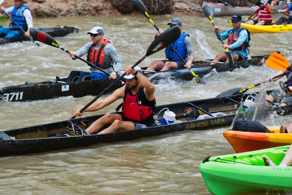 Kayakers racing in river race in Texas