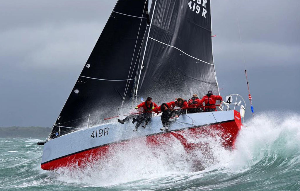 crew sailing in harsh conditions