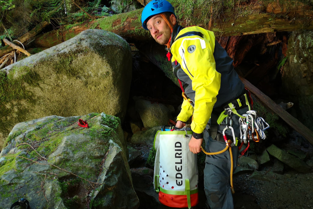 canyon guide sorting gear on wet rocks