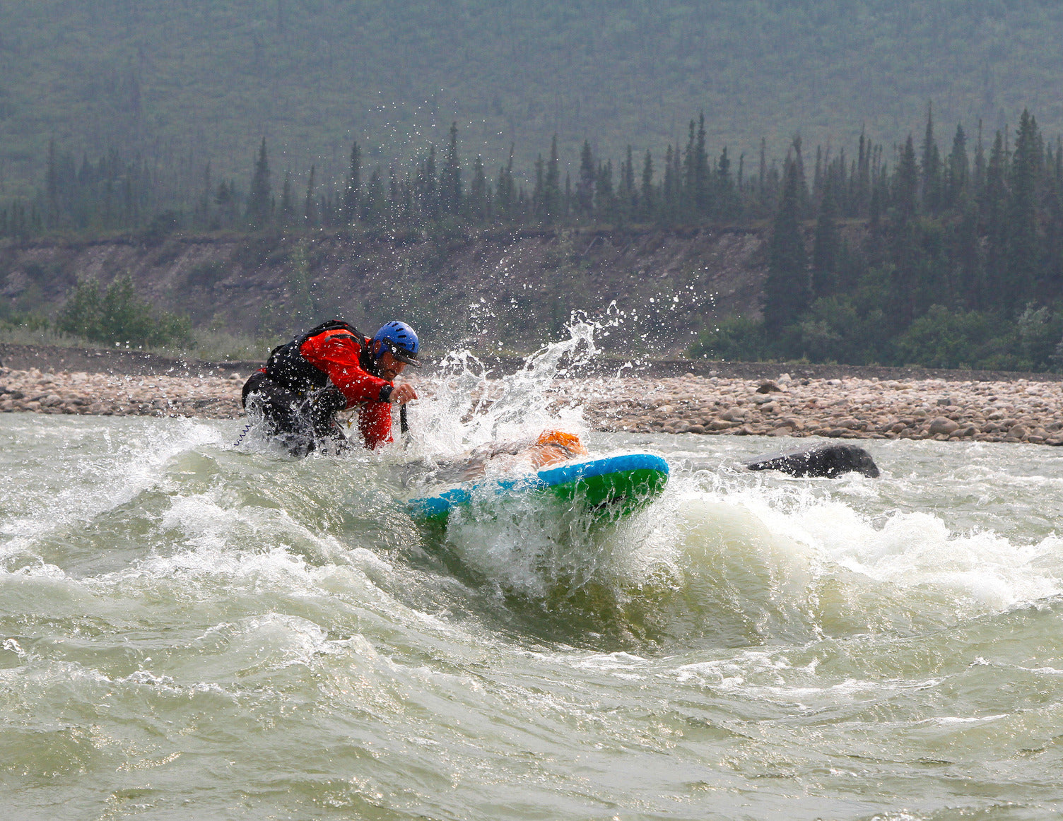 man whitewater rafting in canada