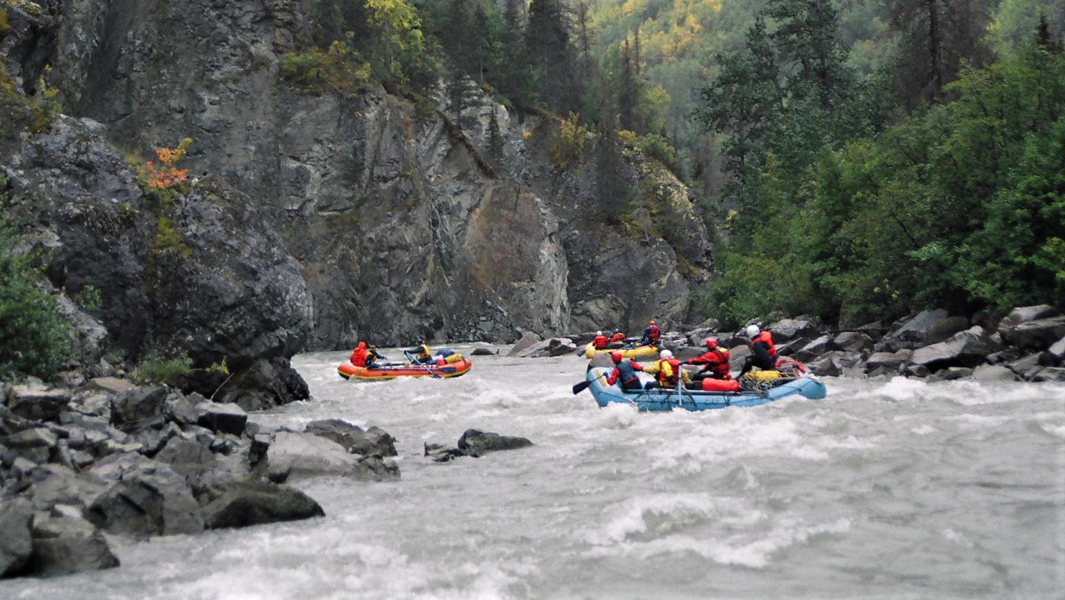 rafts navigating through whitewater conditions