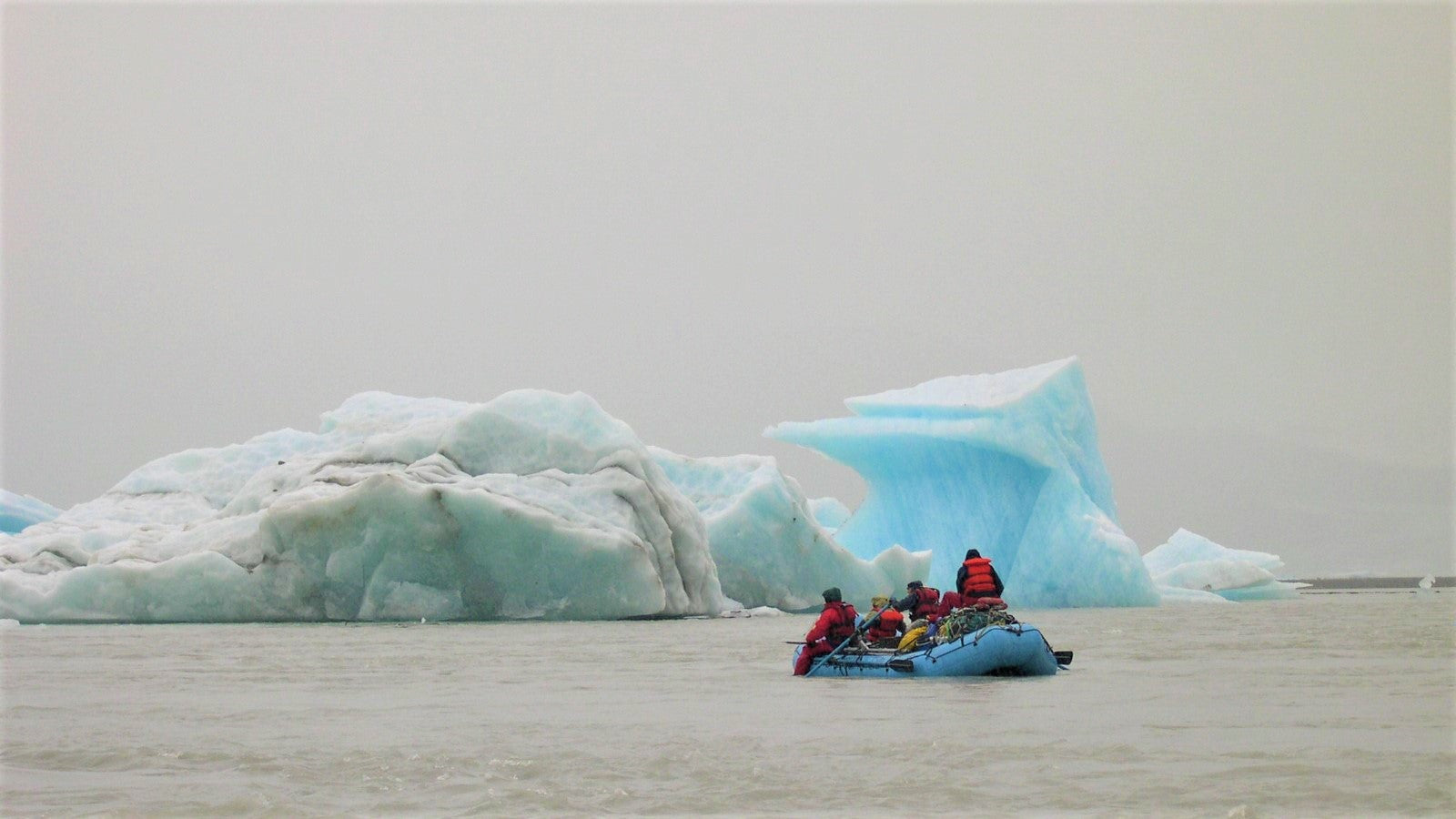 team of rafters by icebergs