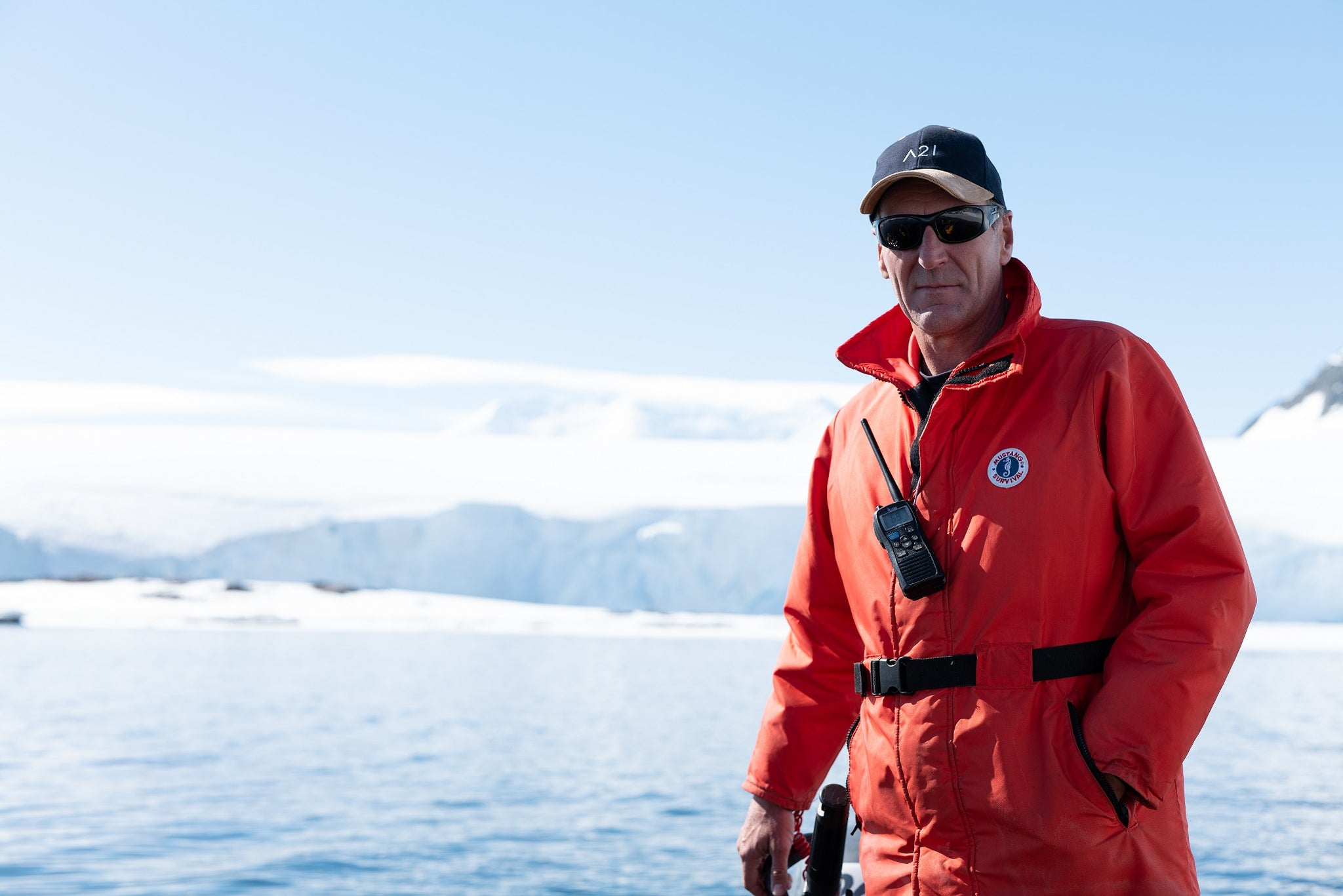 Antarctic Guide Snowy, rocking his orange Mustang Survival Float coat, basball cap, no gloves