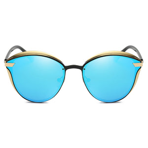 blue tinted lens with gold frames and black bridges. small round frame shape with angular edge