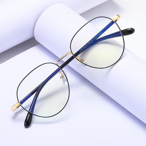 Round eyeglasses with gold frame