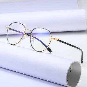 round frame eyeglasses with gold trimmed and black temples