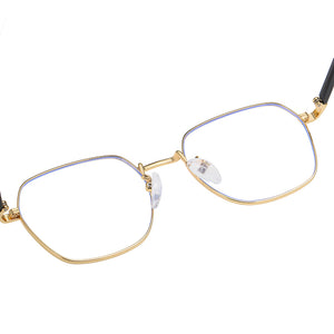inside of the gold rimmed eyeglasses, adjustable nose pad