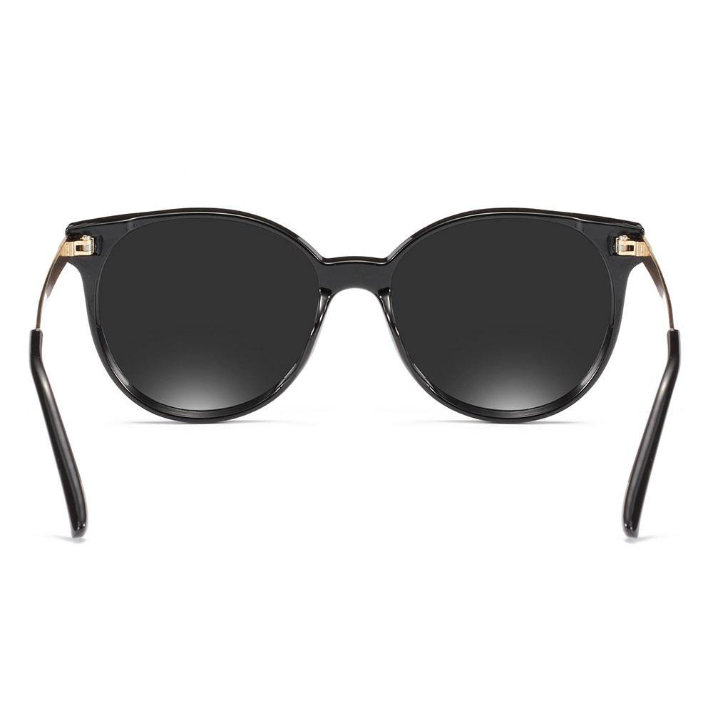 Back side of the round cat eye sunglasses, gold temple arms and black ending tips