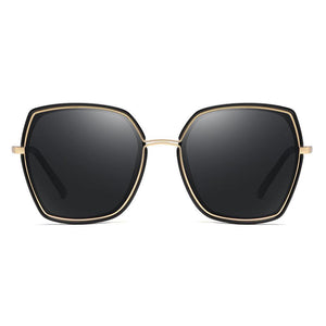 black square sunglasses with gold trim inserted in the frames