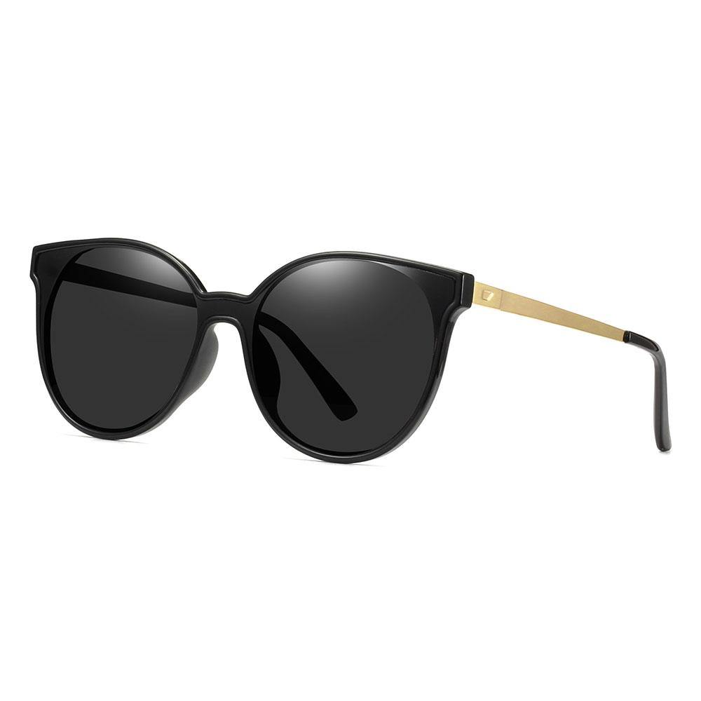black round cat eye sunglasses with gold temple arms and black ending tips