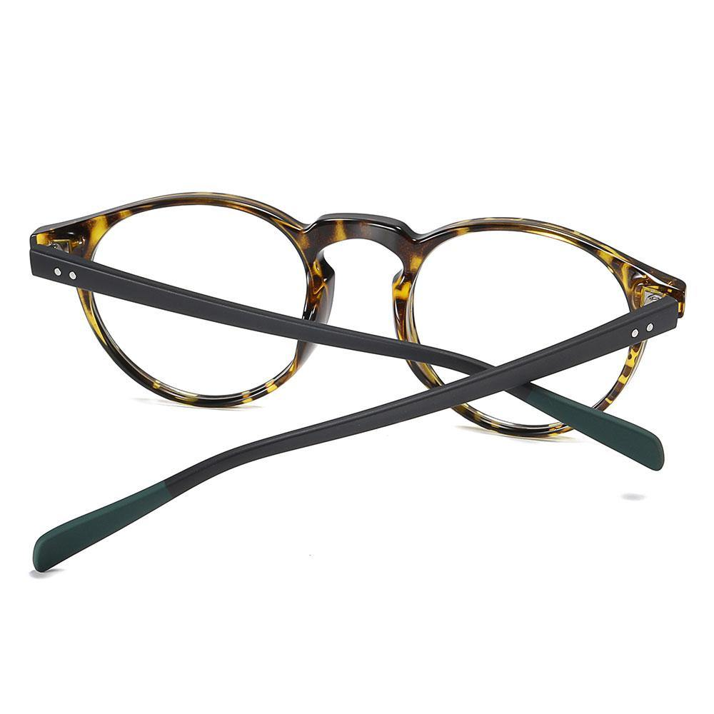 Black temple arms with green ending tips for the round eyeglasses