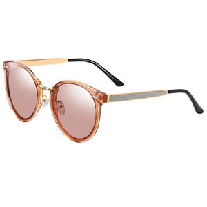 circle sunglasses with jam red lens colors, gold temple arms with black ending tips
