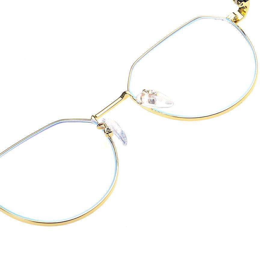 Adjustable nose pads and lens rimmed with gold