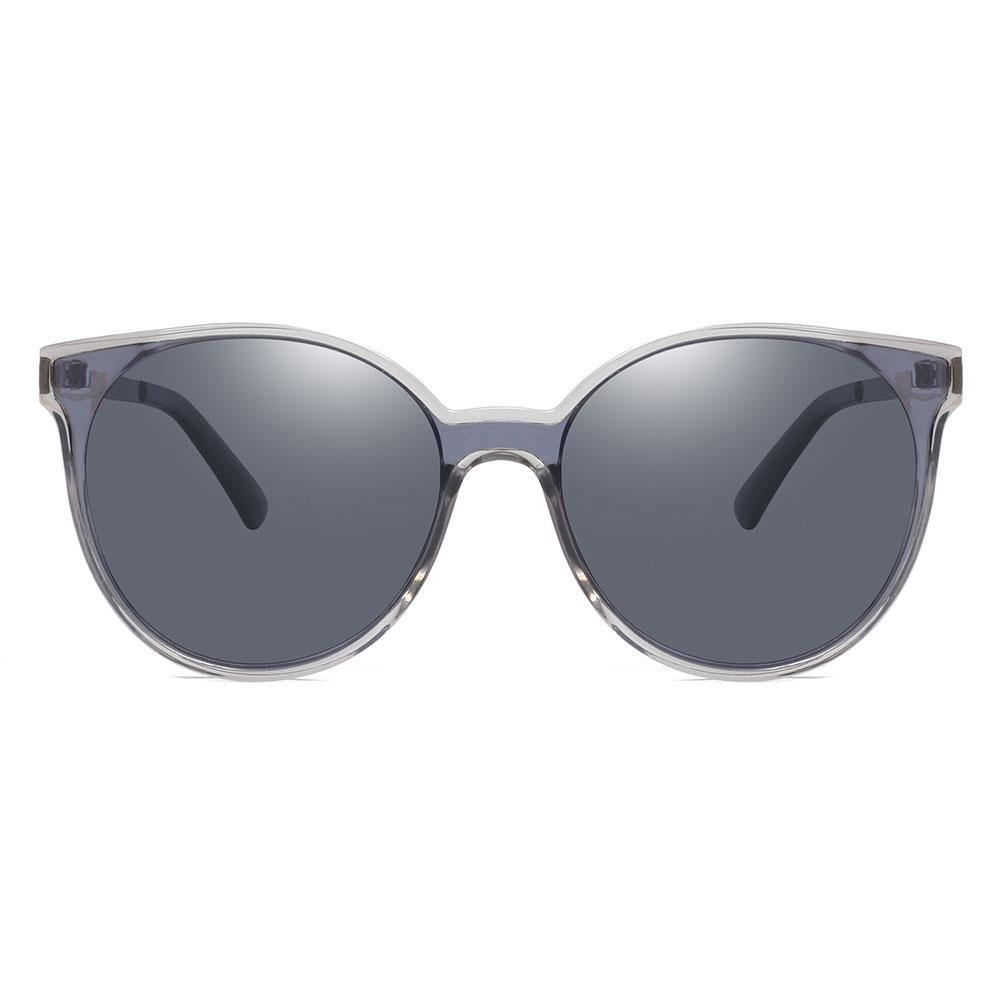 Dark blue or grey round sunglasses, slight aviator style for women