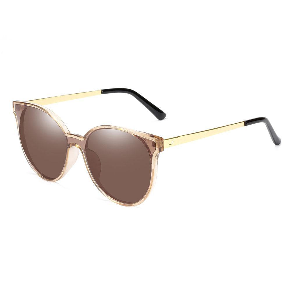 Round brown sunglasses with gold temple arms and black ending tips