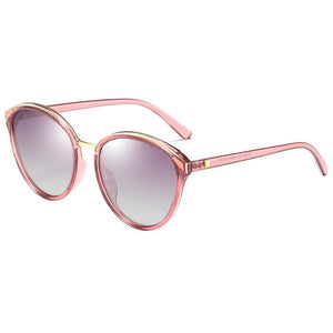 side view of sun shades, purple gradient lens and clear pink frames