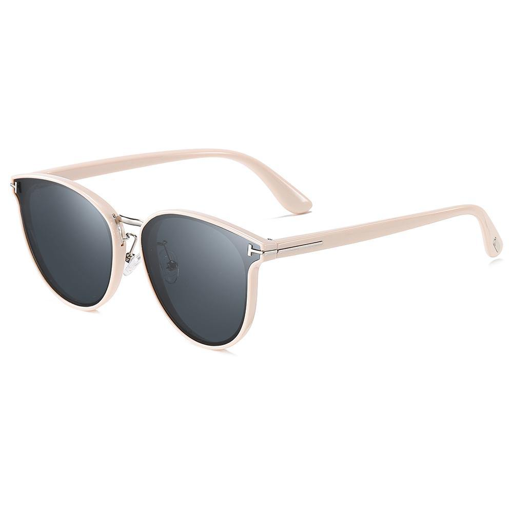 light pink trimmed frame and temple arms, black lens sun eyewear