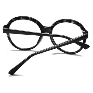temple arms of big round black eyeglasses