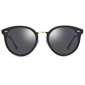 round sunshades with black tinted lens and frames, gold nose bridge