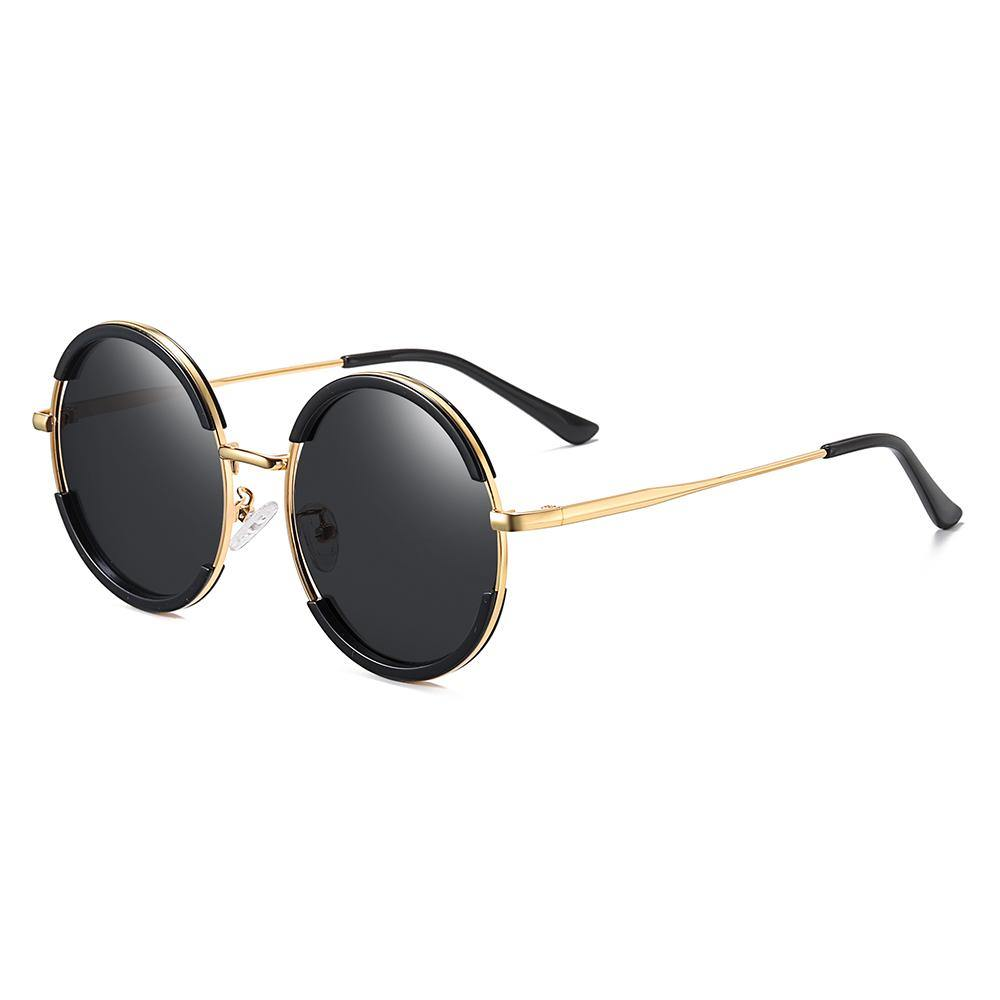 side view of vintage round sunglasses, hippie style, gold frame and temple