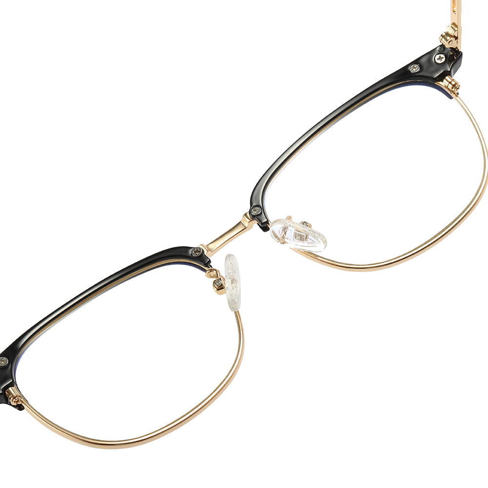 eyeglasses of gold nose bridge with black browline frames