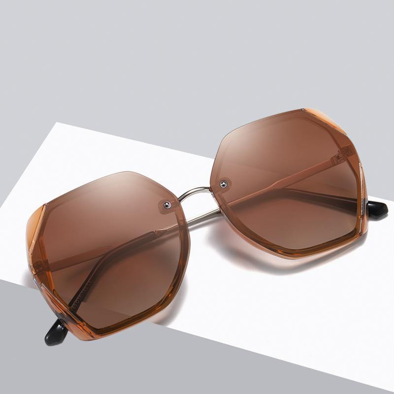 trendy brown sunshades and silver nose bridge