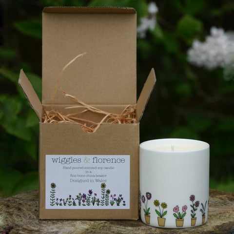 Flower Pots beaker filled with scented candle