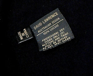 David Lawrence black jersey dress, draping style, with pockets, sz. 12/M, NWOT