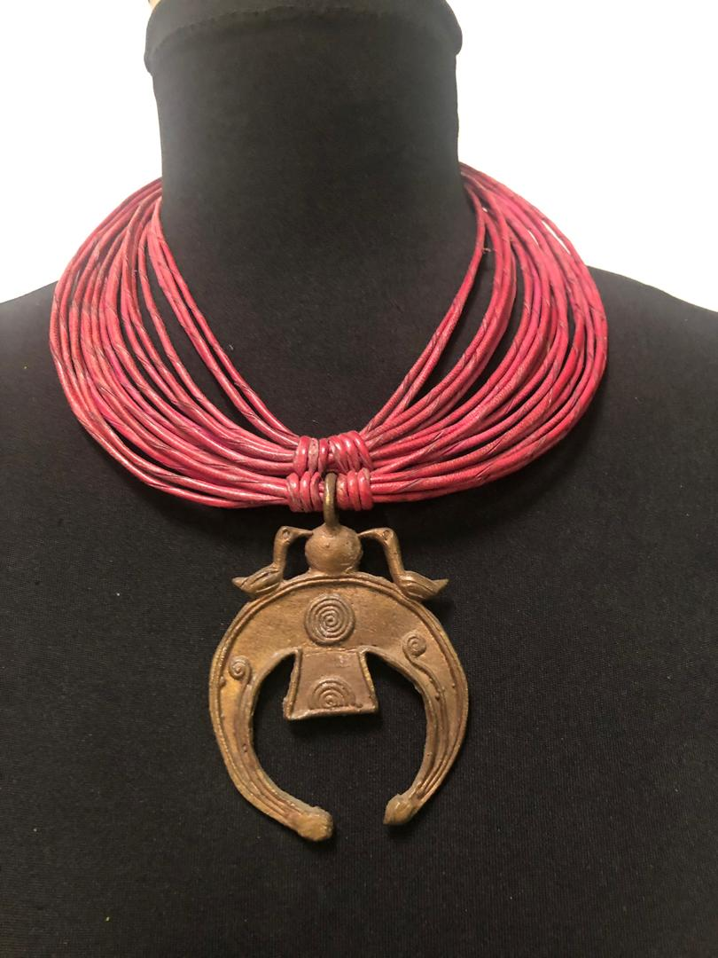 Leather-Strips-Carved-Pendant-Necklace.jpg