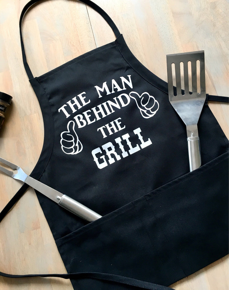 The Man Behind The Grill • Apron -