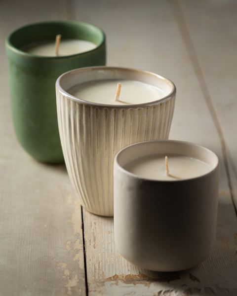 Three soy wax candles poured into rustic Portuguese Stoneware vessels