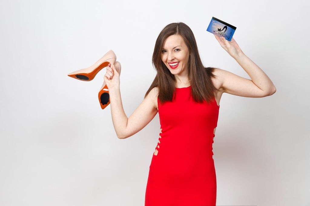 Woman happy with her high heels that are made easier to walk in with anti-slip sole pads for bottom of shoes called Catwalk Clawz.