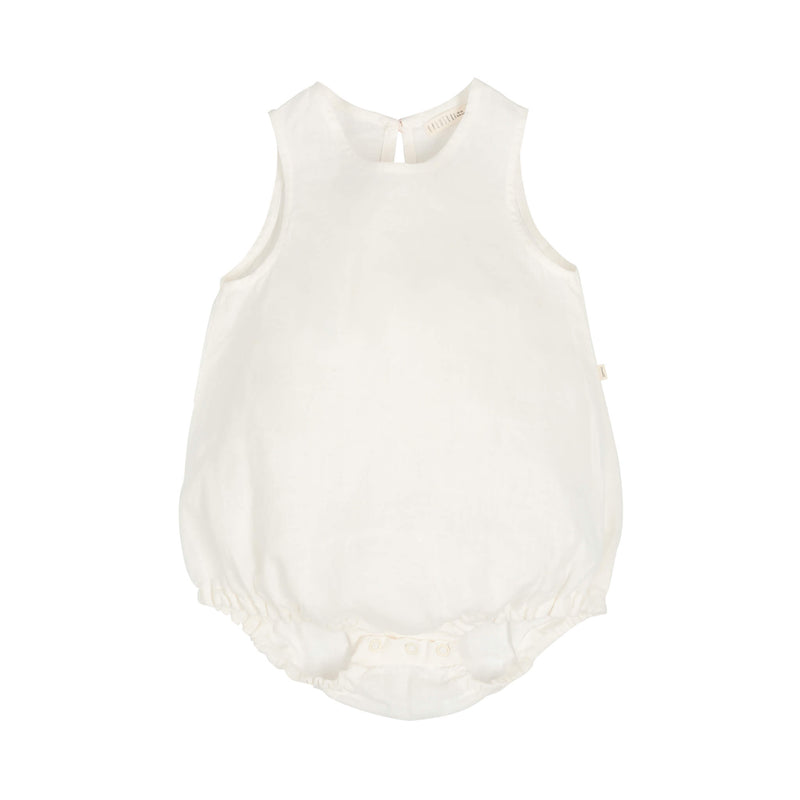 White linen baby girl bubble romper, sleeveless, with button closure at the back and the small tag in the sideseam with letter K. Soft elastic  gathers leg openings.