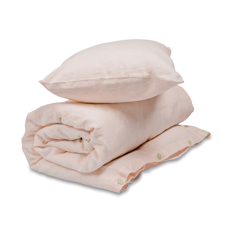 Petal Pink linen bedding set for babies and kids. Rolled up Duvet in duvet cover with pillow in pillowcase on top. Baby and kids linen bedding in pink.