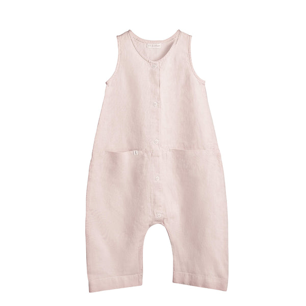 Sleeveless Oversized pink linen baby girl romper with two front inseam pockets, snap opening at the front and small tag with letter K on the pocket.