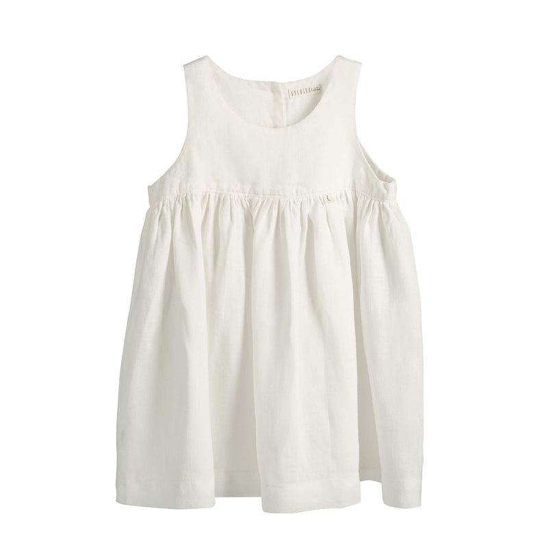 White linen, baby girl,  sleeveless dress with gathers at the waist and back opening and small tag with letter K in the waist seam.