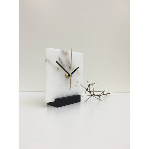square marble clock on black oak stand