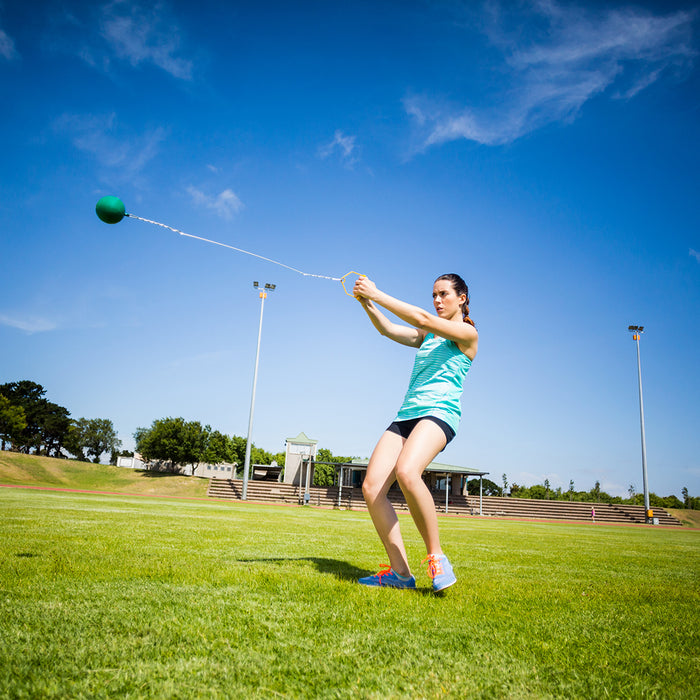 Female athlete throwing the hammer