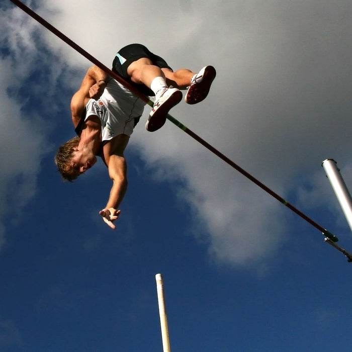 Man Polevaulting by Frans Vledder on UnSplash