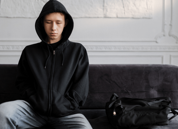 Mental Health in sport: Athlete wearing heavy clothing sitting on a bench